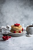 Stacked pancakes with raspberries for breakfast (USA)