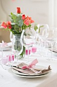 A table set with roses and candles