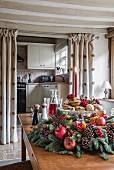 Luxuriant Christmas wreath on wooden table