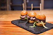 Mini burgers of red tuna on a slate board