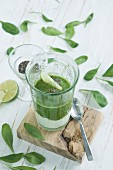Green smoothie, ingredients, chia seeds, yogurt, spinach, avocado, cucumber, pear and lime