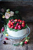 A buttercream cake with berries