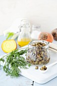 A jar of capers with dill