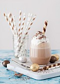 Chocolate Milkshake with whipped cream chocolate flakes foil wrapped chocolate eggs