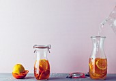 Beauty water with orange, lemon and apple balsamic vinegar