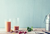 Redcurrant and soya smoothie with peaches and cashews