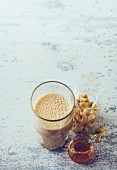 Almond and cashew iced coffee with maca
