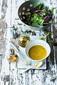 Homemade vinaigrette and lettuce