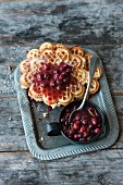 Waffles with cranberry and red wine sauce