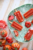 Plate of tomato ice lollies