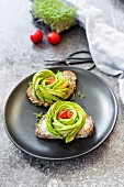 Avocado rose, bread, cress and tomatoes
