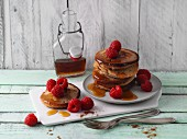 Buckwheat pancakes with fresh raspberries and maple syrup
