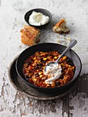 Vegetarian unripe spelt grain chilli with sweet lupin
