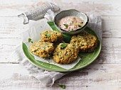 Falafel rissoles with harissa and yoghurt dip