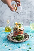 Panzanella salad with balsamic dressing in a glass jar
