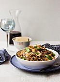 Tagliatelle with a vegetarian bolognese made of mushrooms and lentils, with Parmesan, fresh basil, and red wine
