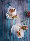 Sweet breakfast wraps with peanut butter, raspberries, avocado and popped amaranth seeds