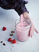 A breakfast shake with coconut milk, strawberries and chia seeds