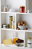 Food items on kitchen shelves