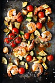 Oven-baked prawns with mushrooms, courgette and cherry tomatoes