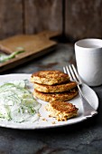 Tuna and carrot fritters with cucumber and dill salad