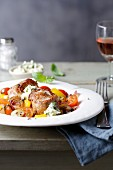 Pork medallions with yellow pepper and cherry tomatoes