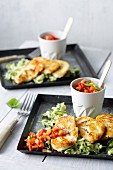 Fried halloumi on a bed of courgette salad with papaya and tomato salsa