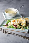 Fried monkfish on a bed of lettuce with orange and pepper sauce