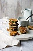 Crispy courgette slices in an almond and parmesan coating with herb aioli