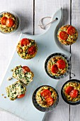 Mini spinach muffins with cherry tomatoes
