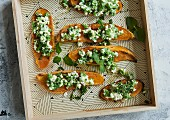 Sweet potato toasts with cream cheese and mint