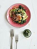 Whole grain pasta with vegetable spaghetti, spinach and pesto