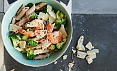 Whole grain penne with prawns, broccoli and parmesan