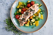 Herbed salmon on a bed of rainbow vegetables