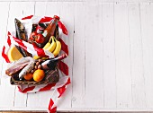 Tomato products, sausage, cheese, smoked fish, fruit, nuts and chocolate