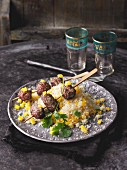 Beef skewers on a bed of couscous