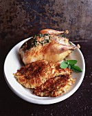 Roast chicken with potato rostis