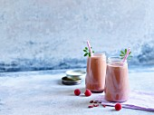 Peach and raspberry smoothie with woodruff and goji berries