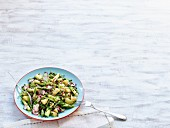 Potato salad with green asparagus, radishes and beluga lentils