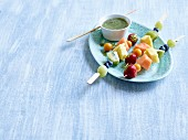 Rainbow fruit skewers with wheatgrass and chia sauce