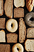 Different types of sliced bread and bagels