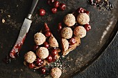 Rye bread with liver sausage balls and sour cherries
