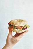 A smoked salmon bagel with wild herbs and cream cheese