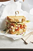 A sandwich with fried rice noodles, prawns and passion fruit mayonnaise