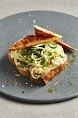 Tonka bean spread, courgette spirelli and flaky pastry triangles on white bread
