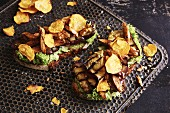 Spelt bread topped with roast chicken breast, aubergine and sweet potato crisps