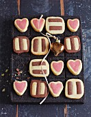 Black and white biscuits, and vanilla and raspberry hearts