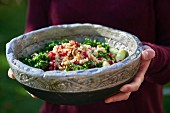 Superfood salad with kale, quinoa and pomegranate seeds