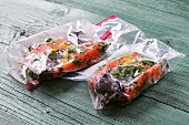 Salmon in plastic bags from the sous-vide