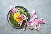 Avocado salad with mango and magnolia blossoms